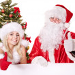 Santa claus and christmas girl holding banner. - Stock Photo
