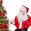 Santa claus by christmas tree thumb up. — Stock Photo