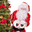 Santa claus by christmas tree. — Stock Photo #7846657