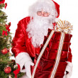 Santa claus by christmas tree. — Stock Photo