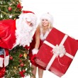 Santa claus and christmas girl. — Stock Photo