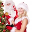 Santa claus and girl decorating christmas tree. — Stock Photo