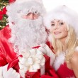 Royalty-Free Stock Photo: Santa claus and christmas girl.