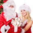 Royalty-Free Stock Photo: Santa claus and  girl giving gift box.