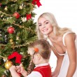 Mum with a daughter decorate christmas tree. — Stock Photo