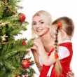 Mum with a daughter decorate christmas tree. — Stock Photo #7846757
