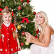 Mum with a daughter decorate christmas tree. — Stock Photo #7846760