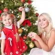 Mum with a daughter decorate christmas tree. — Stock Photo #7846765