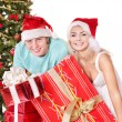 Happy family in santa hat holding gift box. — Stock Photo #7846777
