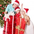 Happy family in santa hat holding gift box. — Lizenzfreies Foto