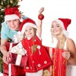 Happy family in santa hat holding gift box. — Stock Photo #7846785