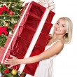 Girl stack gift box by christmas tree.. — Stock Photo #7846802