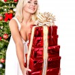 Girl stack gift box by christmas tree.. — Stock Photo #7846811