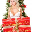 Girl holding gift box by christmas tree.. — Stock Photo #7846821