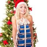 Girl in santa hat holding blue gift box. — Stock Photo #7846835