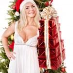 Christmas girl in santa hat giving red gift box. — Stock Photo #7846848