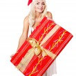 Christmas girl in santa hat holding red gift box. — Stock Photo #7846860