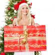 Girl in santa hat holding red gift box. — Stock Photo #7846868