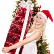 Christmas girl in santa hat giving red gift box. — Stock Photo #7846876