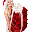 Christmas girl in santa hat holding stack gift box. — Stock Photo #7846880