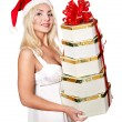 Christmas girl in santa hat holding red gift box. — Stock Photo #7846886