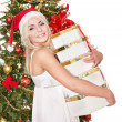 Christmas girl in santa hat holding red gift box. — Stock Photo #7846891