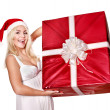 Christmas girl in santa hat holding red gift box. — Stock Photo #7846895