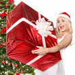 Girl stack gift box by christmas tree.. — Stock Photo #7846898