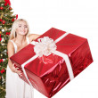 Christmas girl in santa hat holding red gift box. — Stock Photo