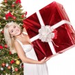 Christmas girl in santa hat holding red gift box. — Stock Photo #7846904