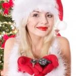 Christmas girl in santa hat holding auto keys. — Stock Photo #7846912