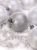 Christmas ball and beads in snow. — Stock Photo