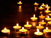 Group of candles on black background. — Zdjęcie stockowe