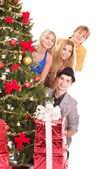 Group young by christmas tree. — Stock Photo