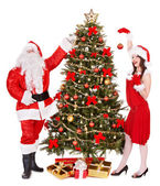Santa claus and girl by christmas tree . — Foto Stock