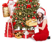 Santa claus and girl by christmas tree and gift box. — Stock Photo
