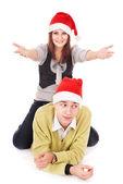 Couple in santa hat. — Stock Photo