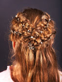 Rear view of hairstyle with braiding. — Stock Photo