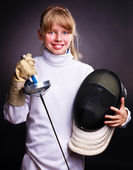 Child in fencing costume holding epee . — Stock Photo