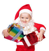 Child in santa costume holding group gift box. — Stock Photo