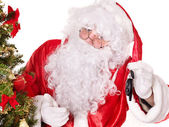 Santa Claus giving auto keys . — Stock Photo