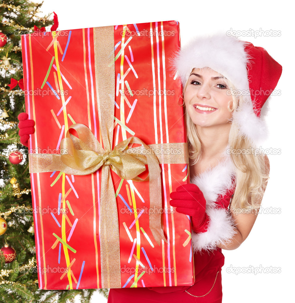 Girl in santa hat holding  gift box by christmas tree.. Isolated. — Stock Photo #7846529