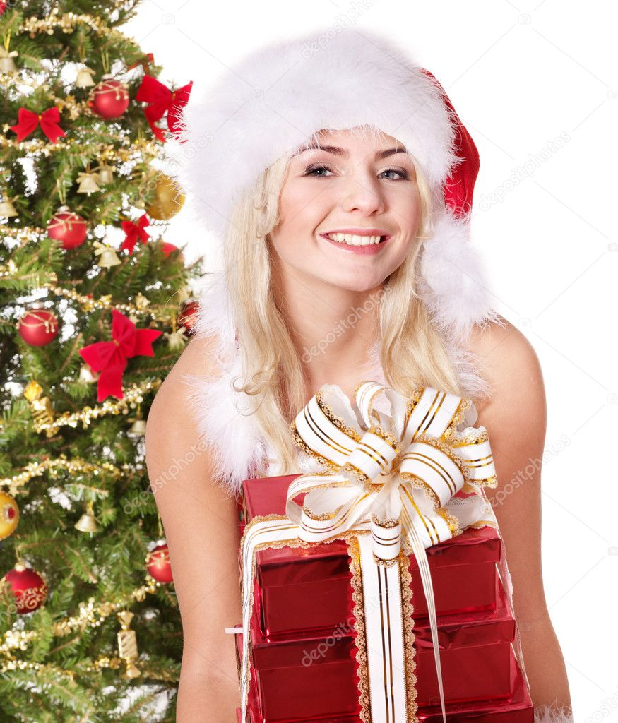 Girl in santa hat holding stack gift box near christmas tree.  Isolated. — Stock Photo #7846539