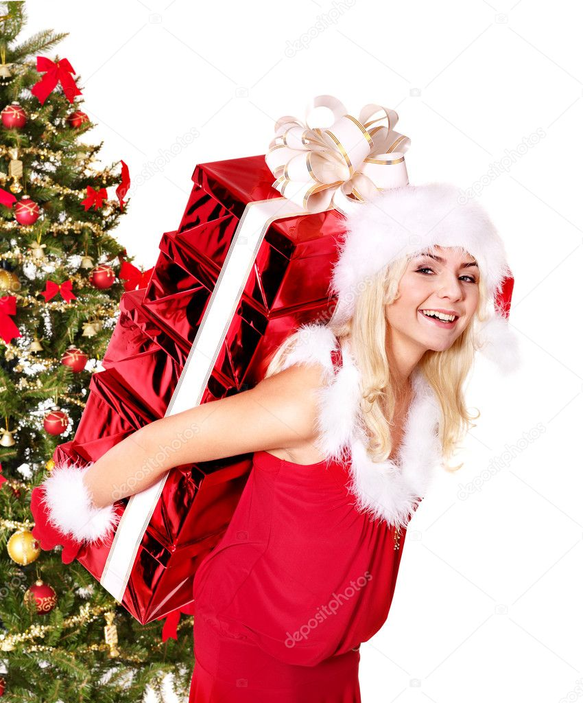 Girl in santa hat holding stack  gift box by christmas tree. Isolated. — Stock Photo #7846545