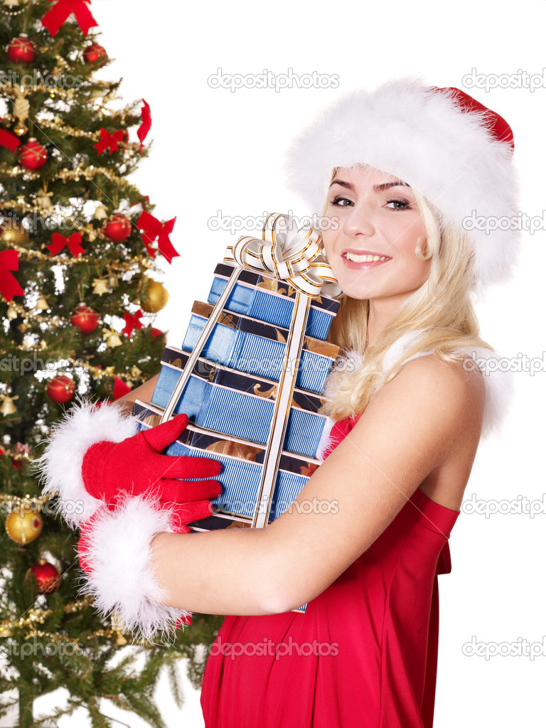 Girl in santa hat holding stack  gift box by christmas tree.. Isolated. — Stock Photo #7846548