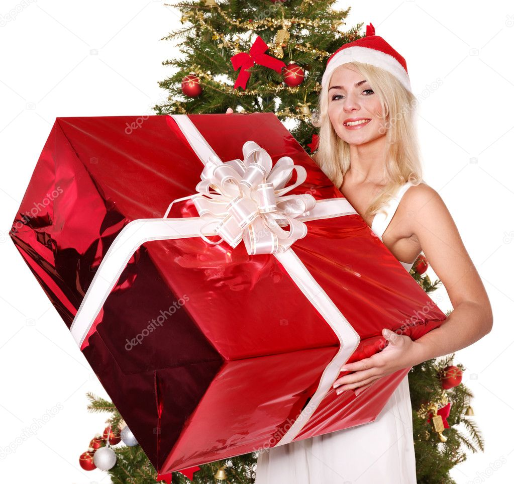 Girl in santa hat holding stack  gift box by christmas tree.. Isolated.  Stock Photo #7846893