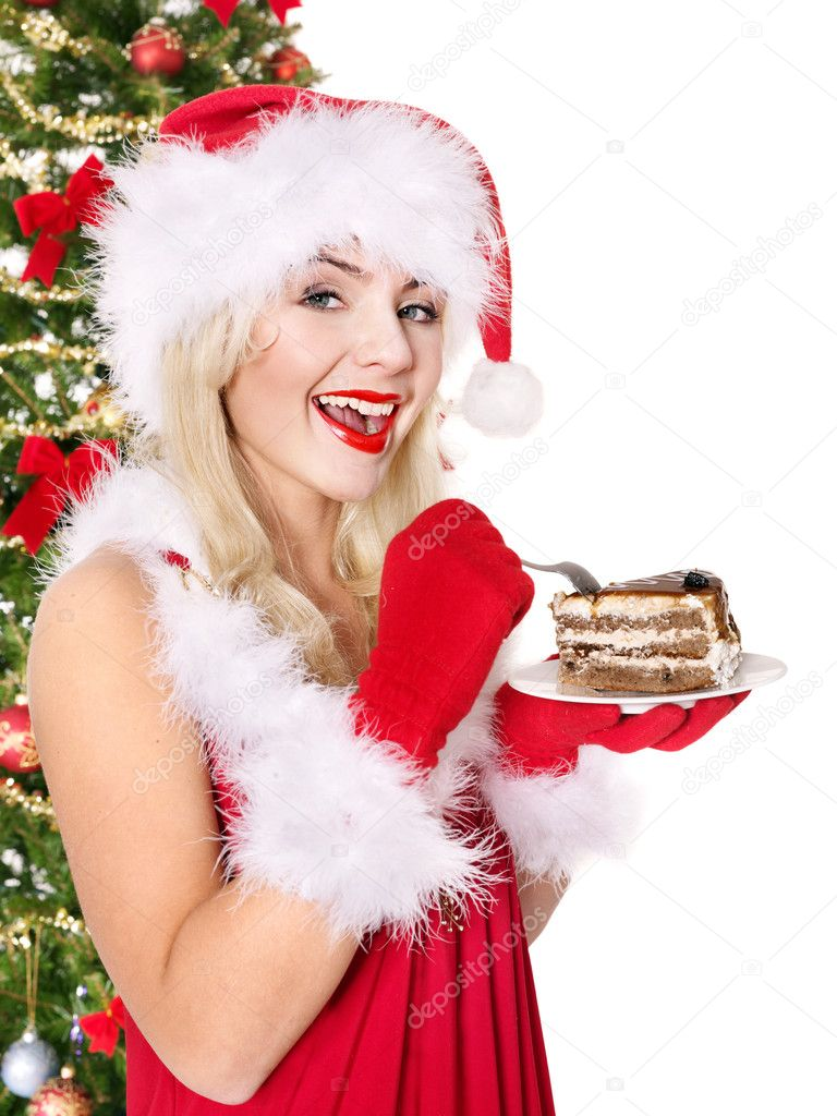 Christmas girl in red santa hat and cake on plate. Isolated.  Stock Photo #7846922