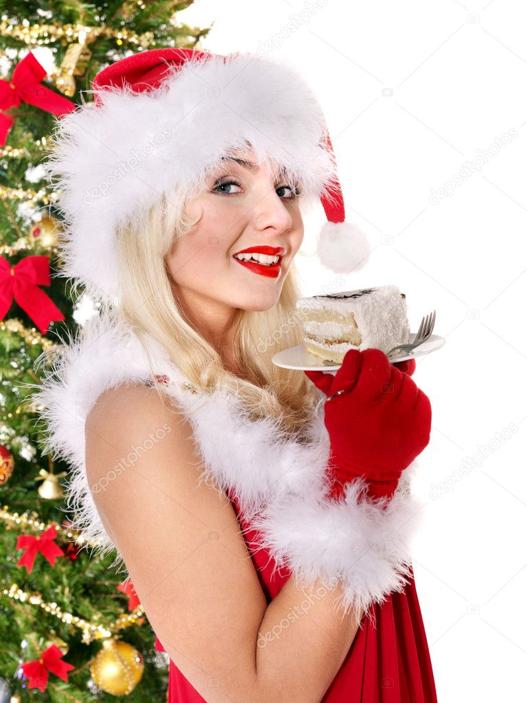 Christmas girl in red santa hat and cake on plate. Isolated. — Stock Photo #7846928