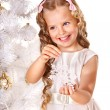 Stock Photo: Child decorate Christmas tree.