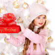 Kid with red Christmas gift box. — Stock Photo